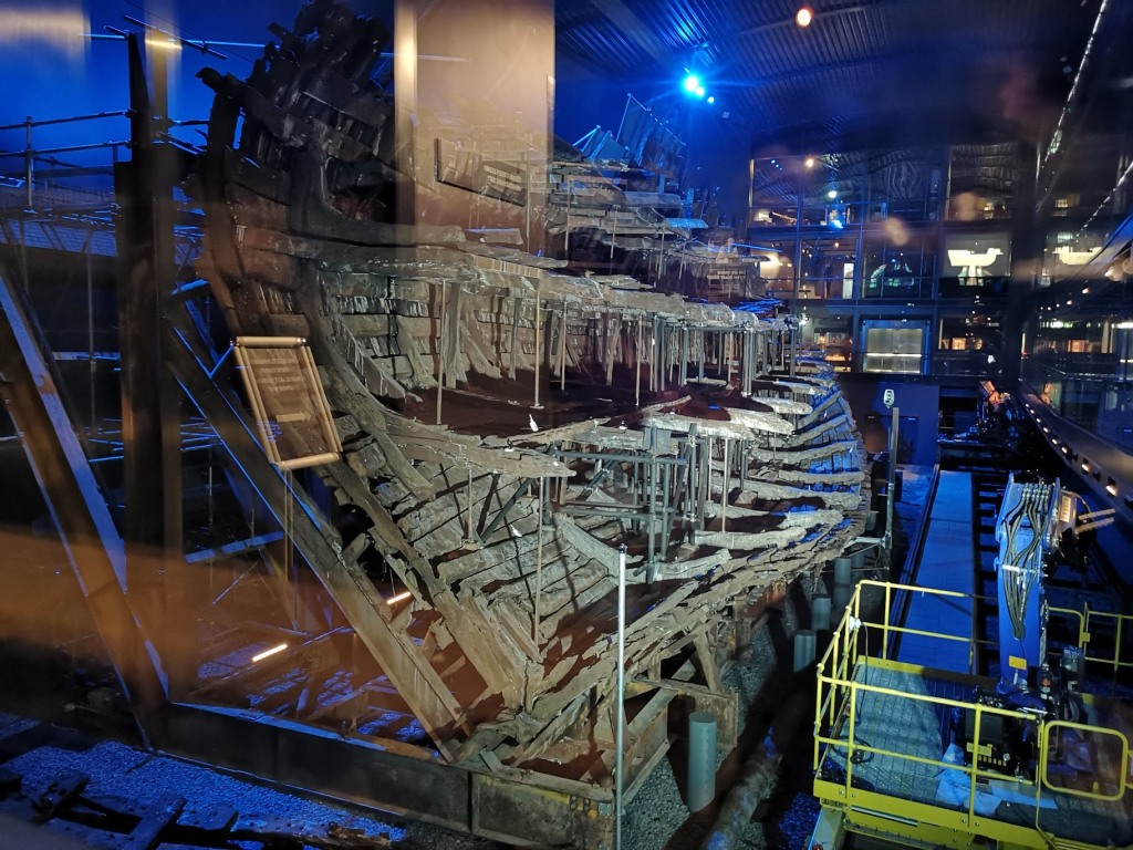 The wreck of The Mary Rose as seen from the lift, is lit by white and blue lights